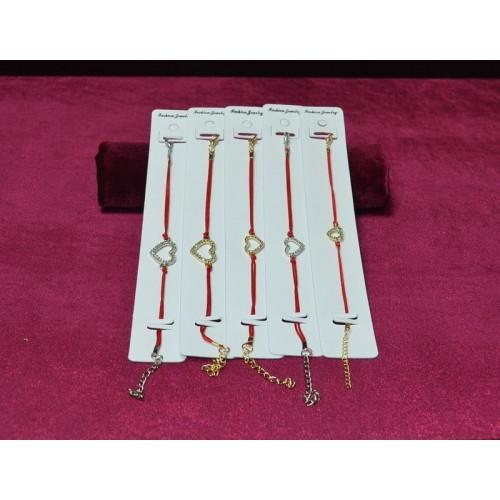 Красная нить - браслет с украшением